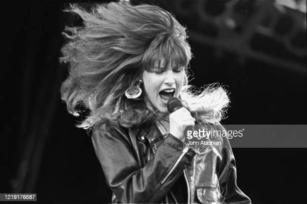 """Singer Tiffany is shown performing on stage during a """"live"""" concert appearance on August 13, 1989."""