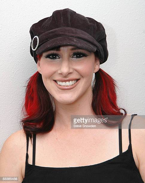 Singer Tiffany poses backstage before performing at Route 66 Legends Theater on August 13, 2005 in Albuquerque, New Mexico. She's on the road in...