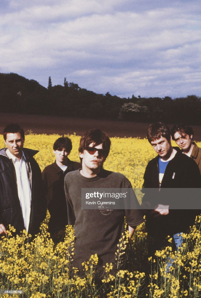 Singer Tim Burgess (centre) with other members of English pop group the Charlatans, 11th May 1995.