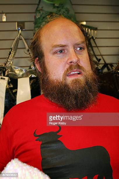 Singer Tim Harrington of Les Savy Fav tries on hats in the souvenir shop during the ATP New York 2008 music festival at Kutshers Country Club on...