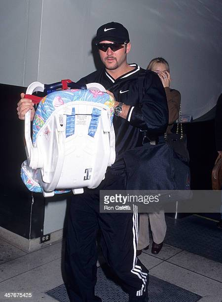 Singer Tim McGraw and daughter Gracie McGraw from Nashville Tennessee on November 17 1997 at the Los Angeles International Airport in Los Angeles...