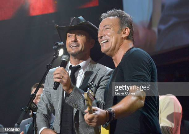 Singer Tim McGraw and honoree Bruce Springsteen perform onstage at MusiCares Person Of The Year Honoring Bruce Springsteen at Los Angeles Convention...