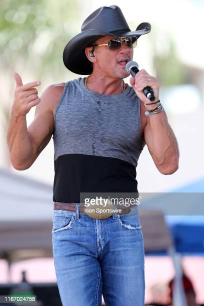 Singer Tim McGraw performs for the fans as part of the teams NFL Fantennial Celebration commemorating 100 years of NFL football before the regular...