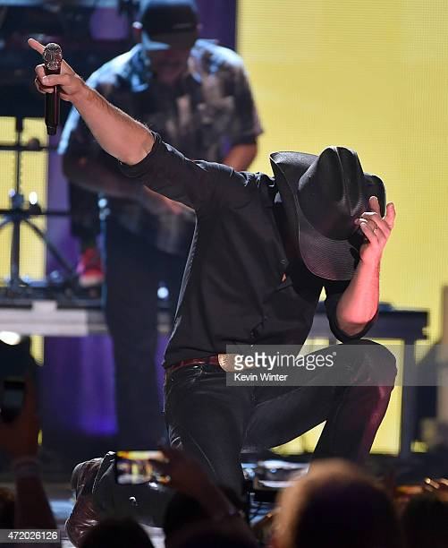 Singer Tim McGraw performs onstage during the 2015 iHeartRadio Country Festival at The Frank Erwin Center on May 2 2015 in Austin Texas The 2015...