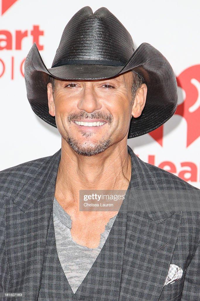 Singer Tim McGraw poses in the iHeartRadio music festival photo room on September 21, 2013 in Las Vegas, Nevada.