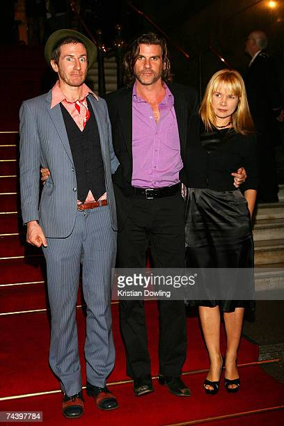 Singer Tim Rogers from UMI Singer Tex Perkins and his partner Kristyna Higgins arrive for the 2007 APRA Music Awards at Melbourne Town Hall on June 5...