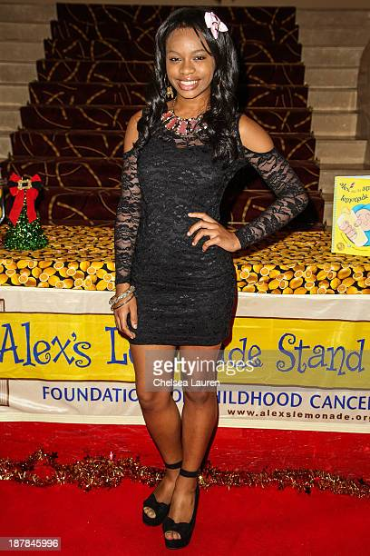 Singer Timyra Joi arrives at A Country Christmas VIP screening hosted by miss Caitlin Carmichael to benefit Alex's Lemonade Stand on November 12 2013...