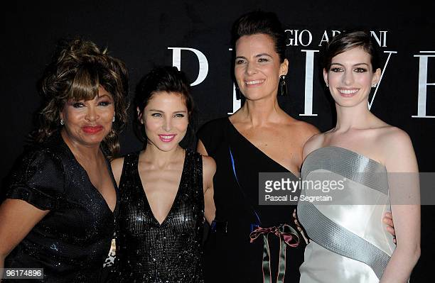 Singer Tina Turner Actresses Elsa Pataky and Anne Hathaway pose with Roberta Armani as they attend Giorgio Armani Prive Fashion Show during Paris...
