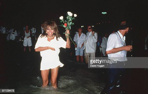 Singer Tina Turner in the sea on New Years Eve in Rio de Janeiro Brazil