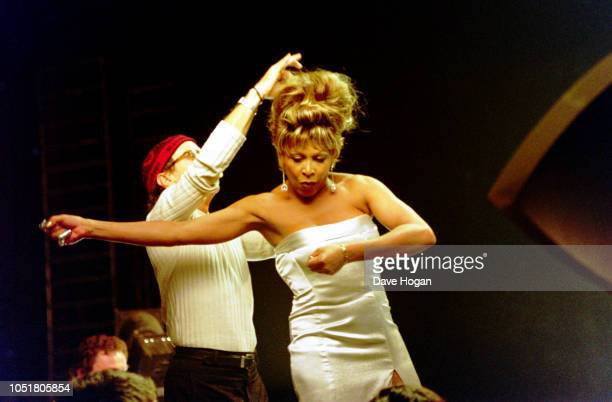 Singer Tina Turner poses for a James Bond style photo shoot at Pinewood Studios in London. She sang the theme song for the 1995 Bond film 'GoldenEye'.