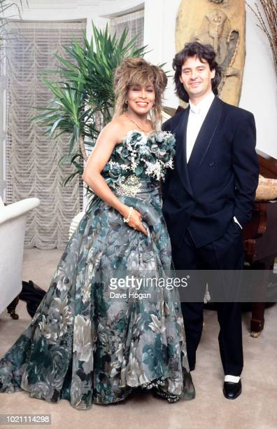 Singer Tina Turner poses with Erwin Bach to celebrate her 50th birthday in November 1989 London
