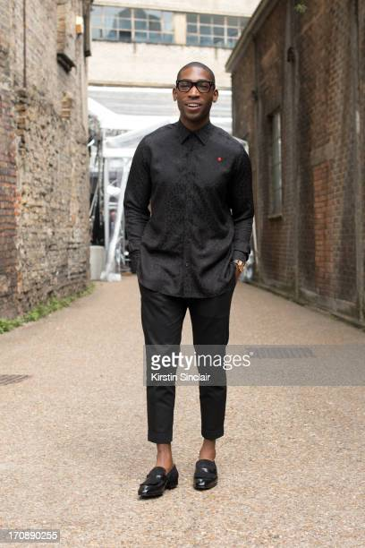 Singer Tinie Tempah wears an Yves Saint Laurent top and Dolce Gabbana trousers on day 2 of London Collections: Men on June 17, 2013 in London,...