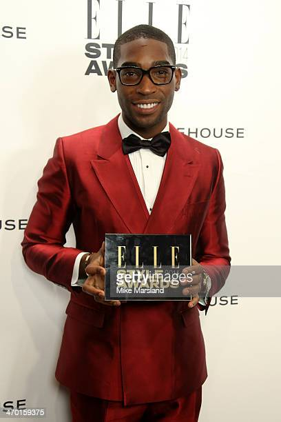 Singer Tinie Tempah winner of the UK Recording Artist Male Award poses in the winners room at the Elle Style Awards 2014 at one Embankment on...