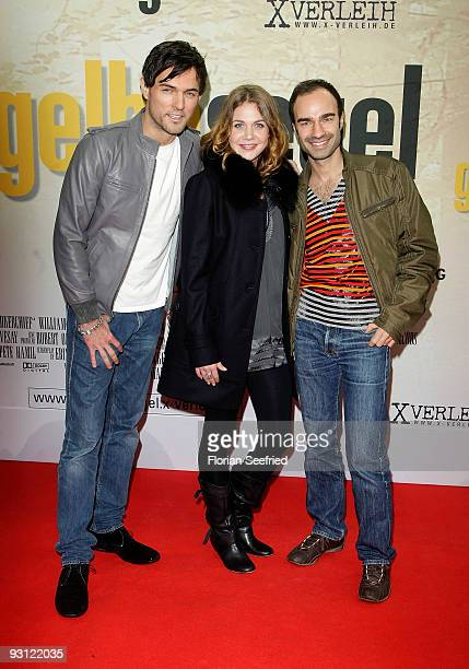 Singer Tobey Wilson actress Felicitas Woll and designer Ivan Strano attend the premiere of 'Das gelbe Segel' at CineMaxx at Potsdam Place on November...