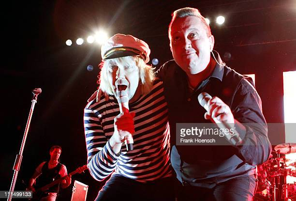 Singer Tobias Kuenzel and Sebastian Krumbiegel of the german band Die Prinzen performs live during a concert at the Tempodrom on April 3 2011 in...