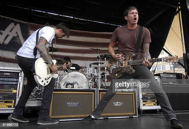 Singer Tom DeLonge guitarist David Kennedy and drummer Adam 'Atom' Willard of Angels And Airwaves performs on the Vans Warped Tour at Comerica Park...