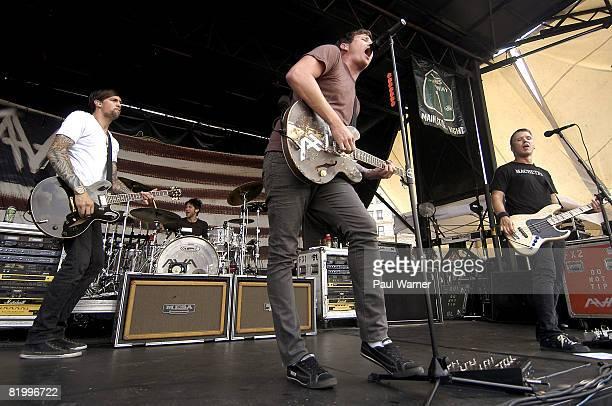 Singer Tom DeLonge guitarists David Kennedy Matt Wachter and drummer Adam 'Atom' Willard of Angels And Airwaves performs on the Vans Warped Tour at...