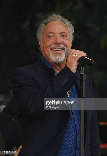 Singer Tom Jones performs during day 3 of the 2011 New Orleans Jazz Heritage Festival at the Fair Grounds Race Course on May 1 2011 in New Orleans...