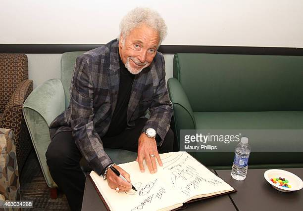 Singer Tom Jones poses backstage at the GRAMMY Charities Signings during The 57th Annual GRAMMY Awards at the STAPLES Center on February 8 2015 in...