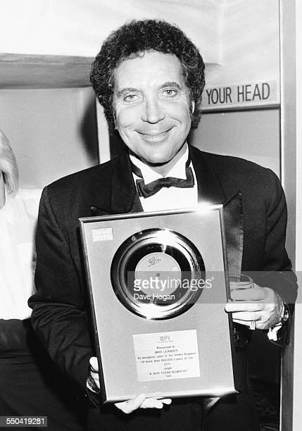 Singer Tom Jones with his gold disc at the Coconut Grove in London June 2nd 1987