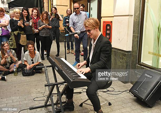 Singer Tom Odell busks on Argyll Street to celebrate the release of his new album Wrong Crowd on June 10 2016 in London England