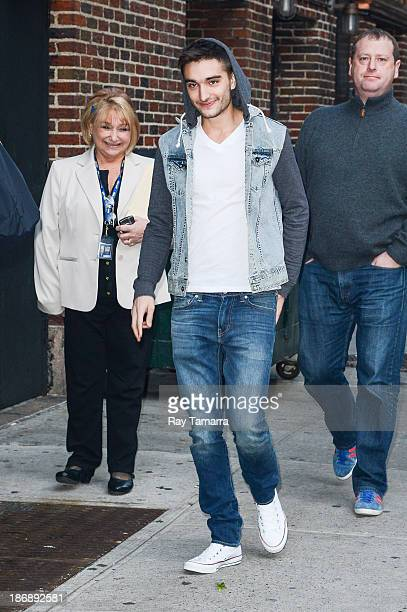 Singer Tom Parker of The Wanted enters the 'Late Show With David Letterman' at the Ed Sullivan Theater on November 4 2013 in New York City