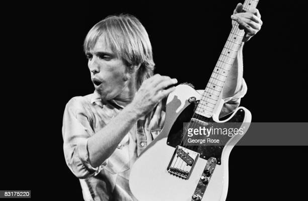 Singer Tom Petty playing the guitar performs on stage during a 1981 Chicago Illinois concert Petty and his band The Heartbreakers were in the middle...