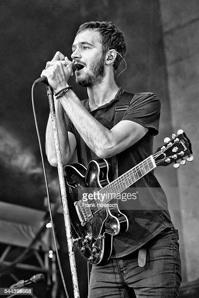 Singer Tom Smith of the British band Editors performs live during a concert at the Zitadelle Spandau on June 28 2016 in Berlin Germany