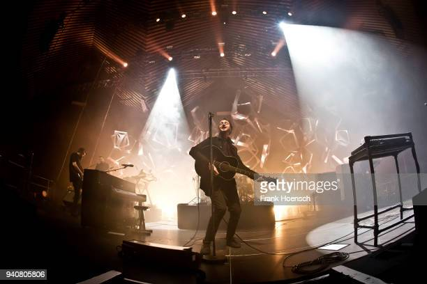 Singer Tom Smith of the British band Editors performs live on stage during a concert at the Tempodrom on April 1 2018 in Berlin Germany