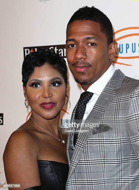 Singer Toni Braxton and TV personality Nick Cannon attend the Stars Get Lucky For Lupus 6th Annual Poker Tournament at Avalon on September 18 2014 in...
