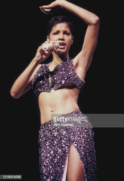 Singer Toni Braxton is shown performing on stage during a live concert appearance on February 8, 1997.
