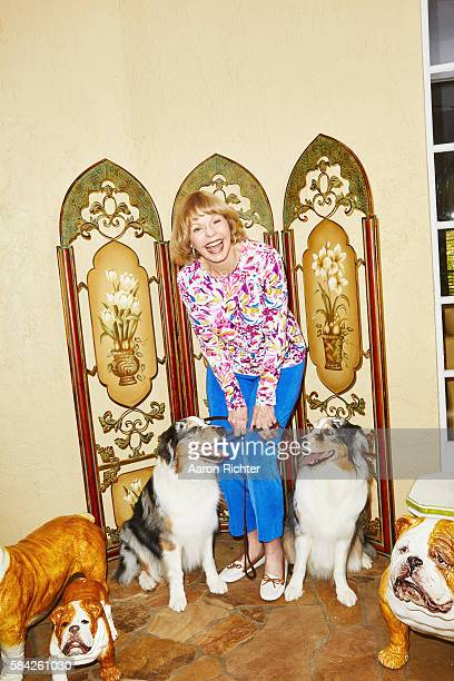 Singer Toni Tennille is photographed with her Australian shepherd dogs Bebop and Lula for People Magazine on March 9 2016 at home in Florida