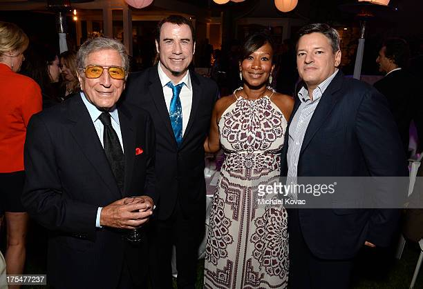 Singer Tony Bennett actor John Travolta Ted Sarandos and Nicole Avant Sarandos attend the 87th birthday celebration of Tony Bennett and fundraiser...