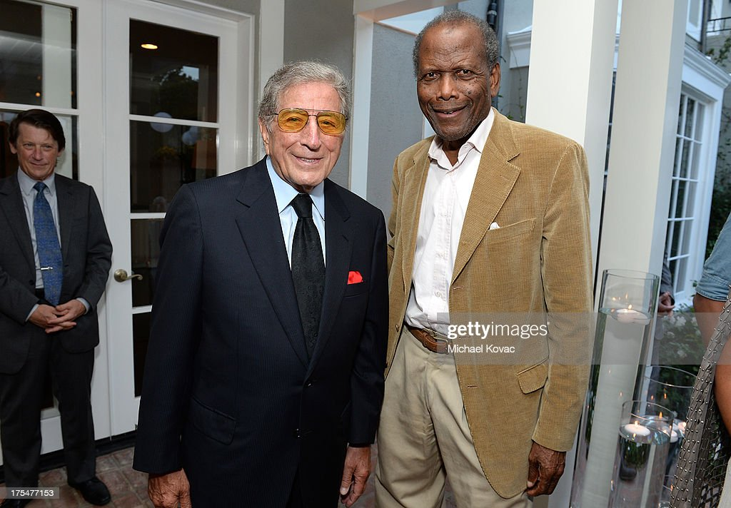Singer Tony Bennett (L) and actor Sidney Poitier attend the 87th birthday celebration of Tony Bennett and fundraiser for Exploring the Arts, the charity organization founded by Mr. Bennett and wife Susan Benedetto, hosted by Ted Sarandos & Nicole Avant Sarandos among celebrity friends and family on August 3, 2013 in Beverly Hills, California.