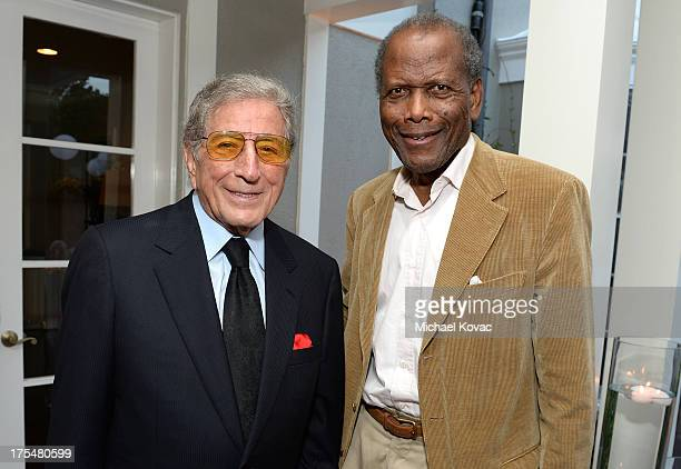 Singer Tony Bennett and actor Sidney Poitier attend the 87th birthday celebration of Tony Bennett and fundraiser for Exploring the Arts the charity...