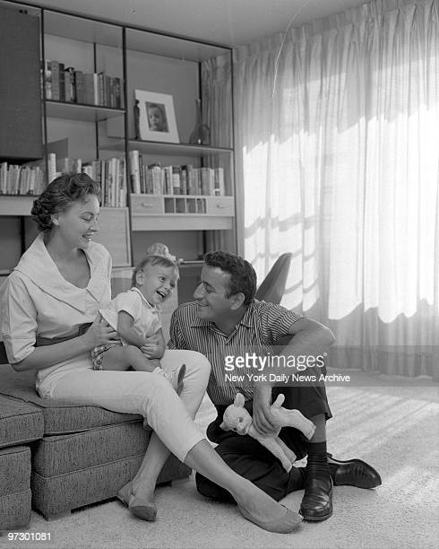Singer Tony Bennett and his wife Sandy smile fondly as their young son D'Andrea gets a spell of the giggles in their apartment in the Riverdale...