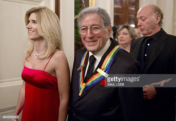 Singer Tony Bennett and his wife Susan Benedetto arrive for a reception for Kennedy Center honorees hosted by US President Barack Obama in the East...