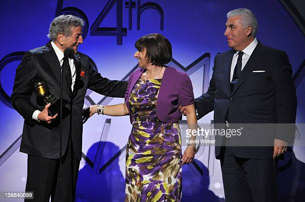 Singer Tony Bennett and parents of the late Amy Winehouse Mitch and Janis Winehouse accept the award for Best Pop Duo/Group Performance for Body and...