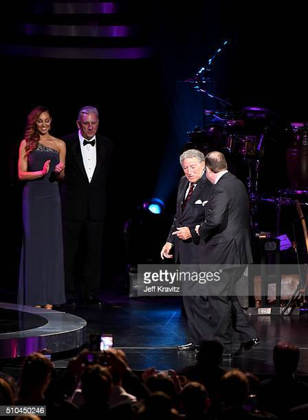 Singer Tony Bennett and pianist Bill Charlap walk onstage to accept the award for Best Traditional Pop Vocal Album for 'The Silver Lining The Songs...