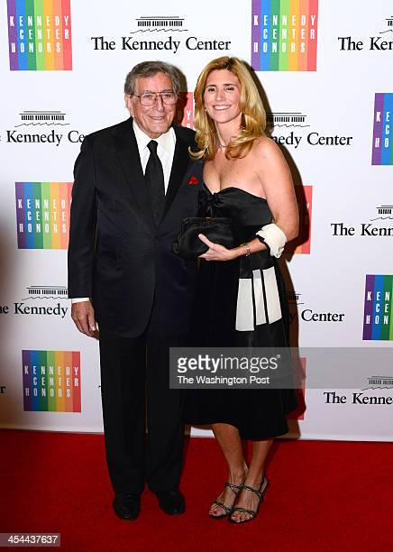 Singer Tony Bennett and wife Susan Crow arrive at a special dinner for Kennedy Center honorees and guests at the State Department in Washington DC on...