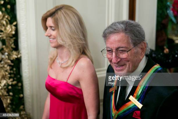 Singer Tony Bennett and wife Susan Crow attend a reception at the White House for the 2013 Kennedy Center Honorees on December 8 2013 in Washington...