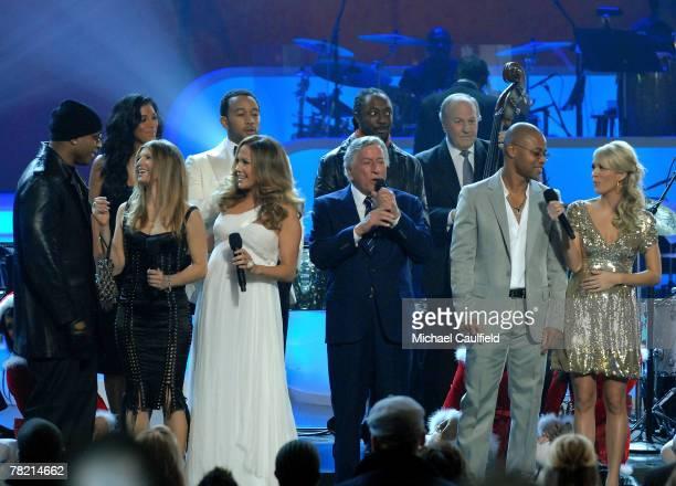 Singer Tony Bennett is joined onstage for White Christmas by LL Cool J Nicole Sherzinger Fergie Jennifer Lopez John Legend william Cuba Gooding Jr...