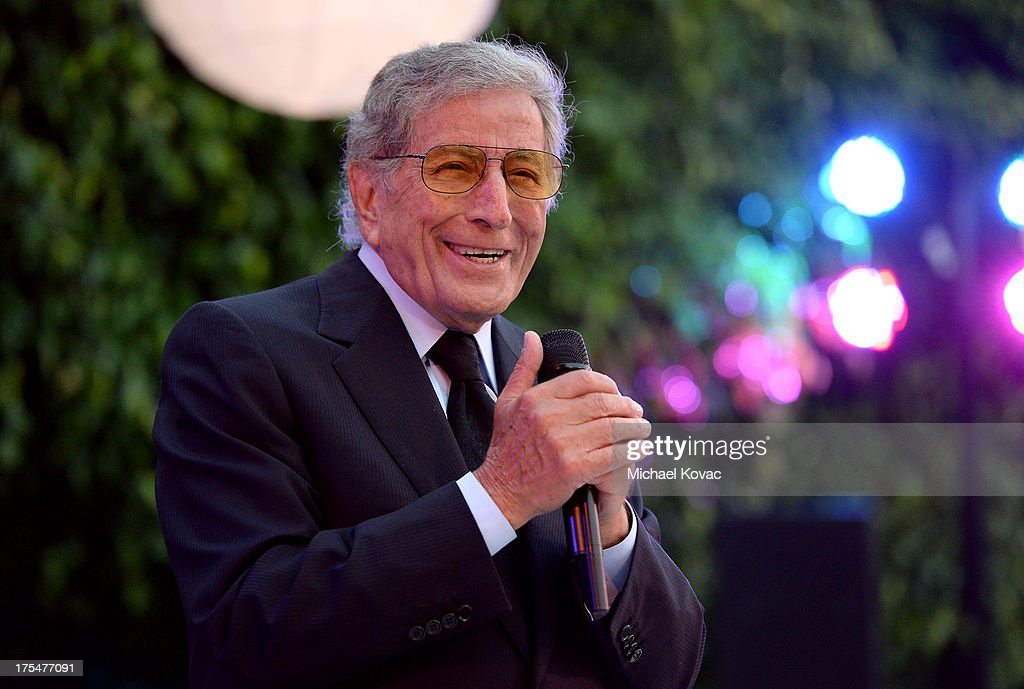 Singer Tony Bennett performs during his 87th birthday celebration and fundraiser for Exploring the Arts, the charity organization founded by Mr. Bennett and wife Susan Benedetto, hosted by Ted Sarandos & Nicole Avant Sarandos among celebrity friends and family on August 3, 2013 in Beverly Hills, California.