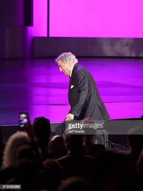 Singer Tony Bennett walks onstage to accept the award for Best Traditional Pop Vocal Album for 'The Silver Lining The Songs Of Jerome Kern' during...