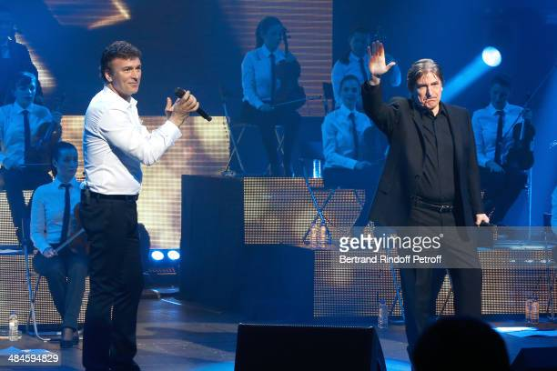 Singer Tony Carreira sings the song 'Une ile' with singer Serge Lama whyle his concert at Palais des Sports on April 12 2014 in Paris France