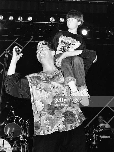 Singer Tony Hadley of the band 'Spandau Ballet' on stage with his son at a concert in Rome 1990