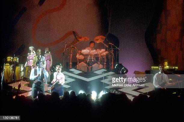 Singer Tony Hadley percussionist Steve Norman bassist Martin Kemp drummer John Keeble guitarist Gary Kemp and keyboardist Jess Bailey of the pop band...