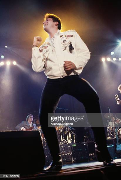 Singer Tony Hadley performing on stage with English pop group Spandau Ballet 1987