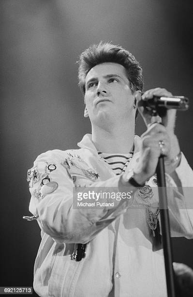 Singer Tony Hadley performing with English pop group Spandau Ballet at the Prince's Trust Concert Wembley Arena London 6th June 1987