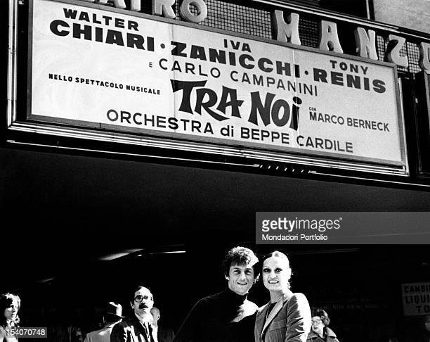 Singer Tony Renis posing with his fiancee Elettra Morini prima ballerina at the La Scala theatre before the Manzoni theatre where the...